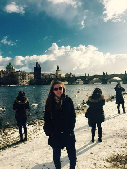 Standing on the bank of the Vltava River in Prague, Czech Republic (February 2015).