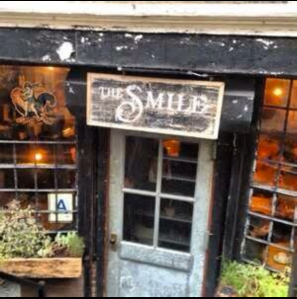 The outside of The Smile cafe in NoHo.  Image courtesy of twitter.com/thesmilenyc