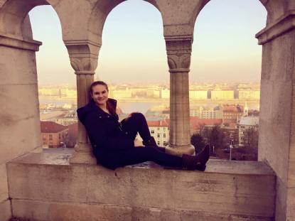 "Sitting on the ledge of Fisherman's Bastion on the ""Buda"" side of the city. Beautiful view of the Danube River."