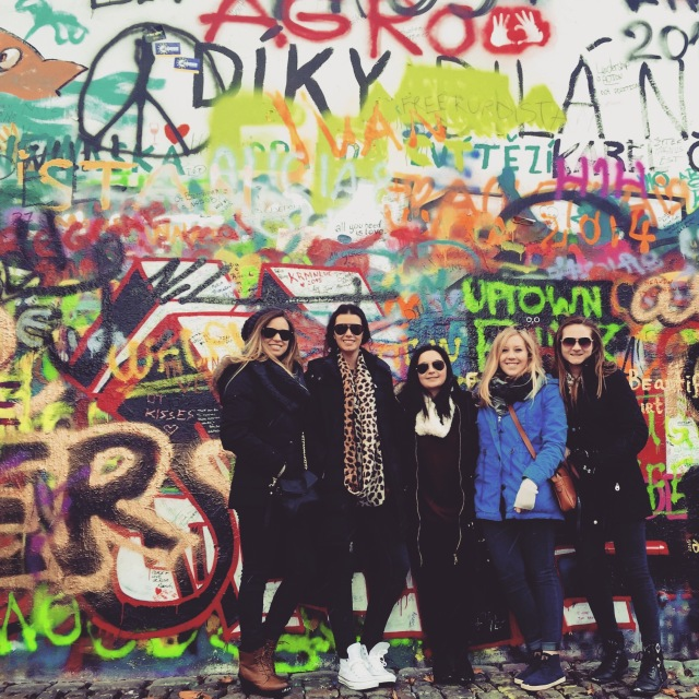 My roommates and I in front of the Lennon Wall