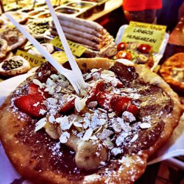 Pushed through the crowd to try a Hungarian Lángos, a food similar to fried dough with Nutella, strawberries, and bananas.