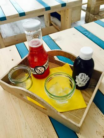 Lemonade served in a ketchup bottle and Cold Drip coffee.