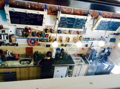 Superheroes can be seen behind the counter in various forms, whether it be mugs or figurines.