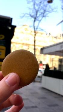 Enjoying a coffee macaron on Rue de Champs Elysees