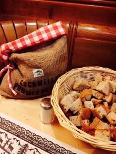 The waiter at Swiss Chuchi brought over a literal sack of hot potatoes and a bread basket to start off our meal.