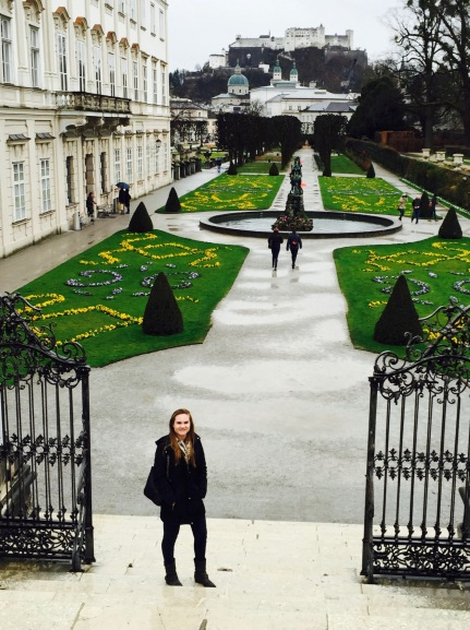 Standing on the steps of the Mirabell Gardens where Maria Von Trapp and the children sang