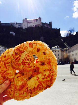 Enjoying a giant pretzel in Residentzplatz.