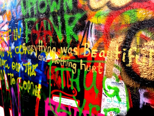 """Everything was beautiful and nothing hurt"" spray painted on the John Lennon Wall"