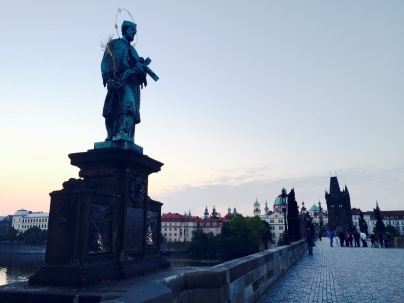St. John of Nepomuk statue on the Charles Bridge at sunrise