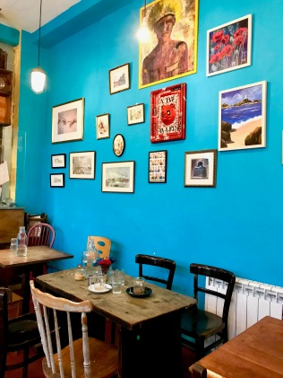 Senzala Creperie interior with blue walls and brazilian artwork